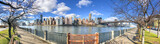 Fototapeta Nowy York - Panoramic view of Midtown Manhattan and East River from Roosevelt Island on a sunny day, New York City © jovannig