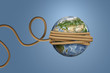 3d rendering of planet Earth, tied with a rope and thrown like a ball or a yo-yo.