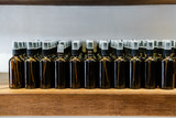 Set of glass dark brown bottles  for cosmetics and medicine products. Minimalism - 242693852