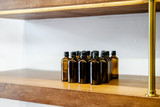 Set of glass dark brown bottles  for cosmetics and medicine products. Minimalism - 242694039
