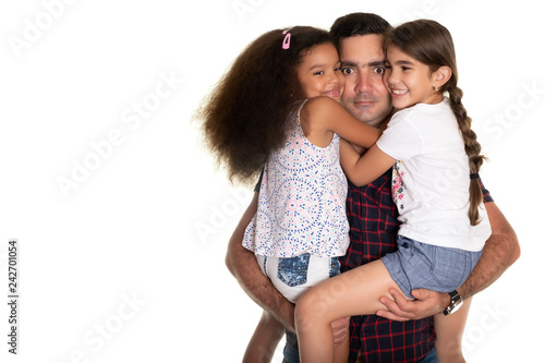 Multiracial family, Hispanic father with a funny expression hugging his mixed race daughters