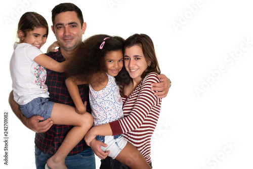 Multiracial family, Hispanic father with his three mixed race daughters