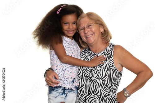 Caucasian older woman hugging her african american granddaughter