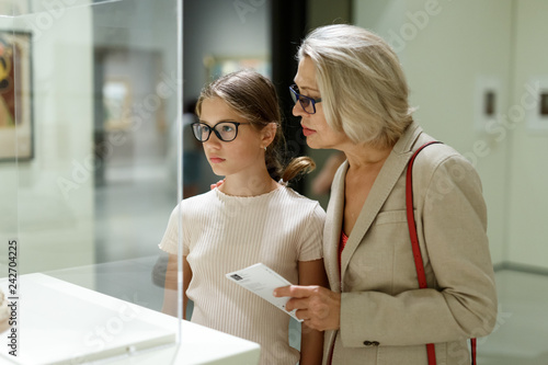 Leinwandbild Motiv Woman and girl visiting museum