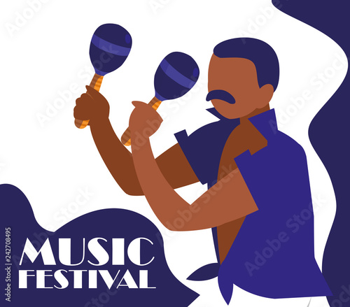 man playing maracas tropical instrument
