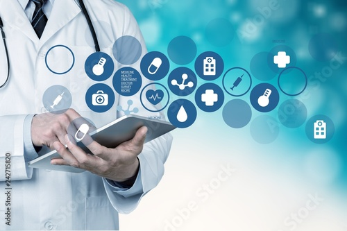 Leinwandbild Motiv Doctor at hospital working with tablet