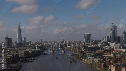 Aerial panning view of Tower bridge and the City of London