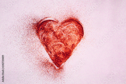 Red glittering graffiti style heart on pink textured wall