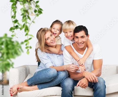 Leinwandbild Motiv Beautiful smiling family on background