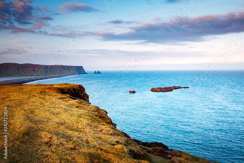 Great view on Kirkjufjara beach and sunny hills. Location place South Iceland, Europe.