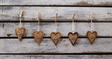 Heart shaped decorations pinned on a rope 4k - 242724220