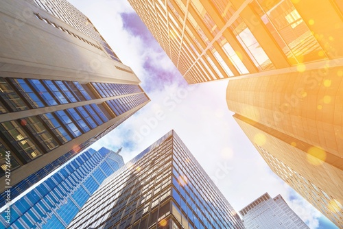 Modern office glass buildings over sky background - 242726646