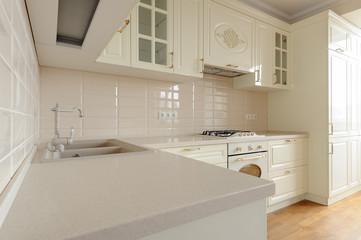 Classic cream colored kitchen closeup © starush