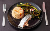 Salmon fillet served with brown rice and roasted tenderstem broccoli - 242751673