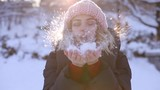 Happy woman blowing snow from hands, slowmotion - 242753865