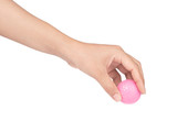Hand holding a pink golf ball isolated on white background
