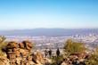 Mountain Hikers Overlooking Phoenix City Skyline