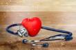 Leinwanddruck Bild - Medical Stethoscope with plastic Heart isolated on white