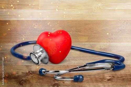 Leinwanddruck Bild Medical Stethoscope with plastic Heart isolated on white