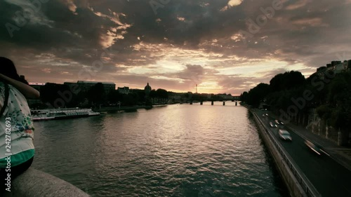 Sunset in Paris over Seine river with Eiffel Tower in the background.
