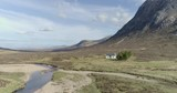 Aerial footage of a small hikers cottage in Glencoe, Scottish Highlands - 242787869