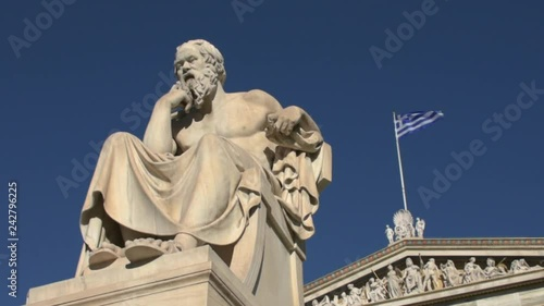 Exterior shot of the facade of the Academy of Athens and the statue of Greek philosopher Socrates, Greece