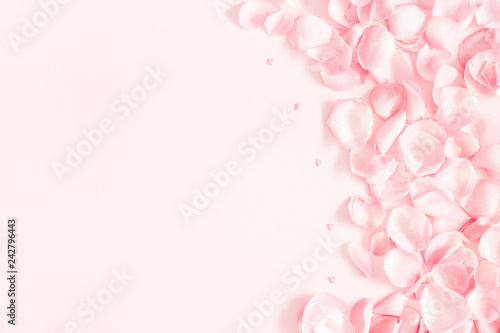 Wall mural Flowers composition. Rose flower petals on pastel pink background. Valentine's Day, Mother's Day concept. Flat lay, top view, copy space