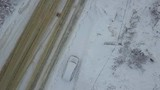 Aerial view of a car trapped in snow and seems broken - 242800845