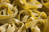 Italian pasta food on wooden background. Garlic, Tomatoes, Basil, Spicy