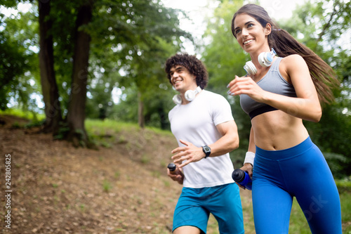 Foto Murales Couple jogging and running outdoors in nature