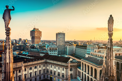 beautiful view at sunset from Duomo cathedral of Milan roof top - italian trave destination - european trip