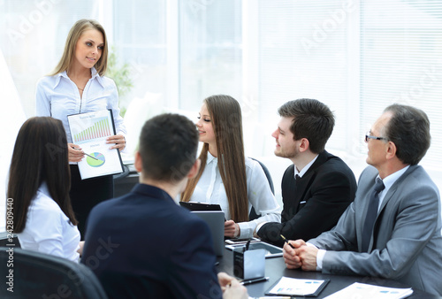 Poster business woman conducting a presentation for business colleagues