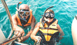 Leinwandbild Motiv Retired couple taking happy selfie in tropical sea excursion with life vests and snorkel masks - Boat trip snorkeling in exotic scenarios on active elderly and senior travel concept around world