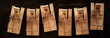 Row of wooden mousetraps on black background