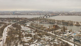 Aerial top view from drone on railway bridge above Dnieper river in Dnipro city. Winter landscape and cityscape background. (Dnepr, Dnepropetrovsk, Dnipropetrovsk) - 242814260
