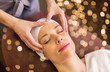 Leinwanddruck Bild - people, beauty, lifestyle and relaxation concept - beautiful young woman lying with closed eyes and having face and head massage at spa