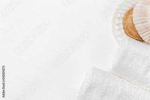 Spa concept. White cotton rolled towels and soap. Spa set. Copy space. View from above.