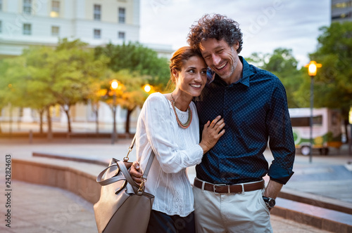 Mature couple in love walking in street