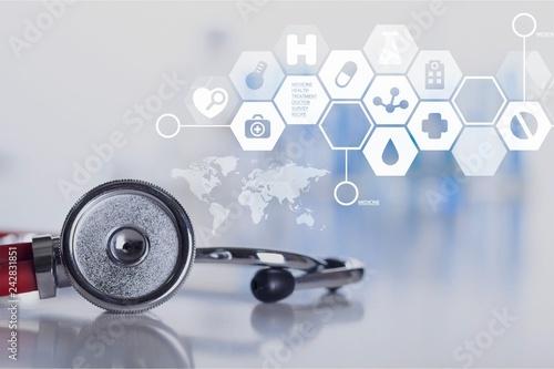 Leinwanddruck Bild Stethoscope object and book  on backgrouund