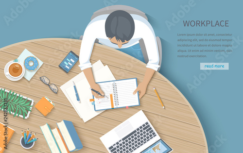 Мan writing notes in a notebook at a round wooden desk. Workplace Desktop Workspace Office supplies, laptop, books, phone, glasses, pen, paper, tea, donuts, flowerpot. Vector Top view