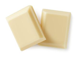 White chocolate pieces isolated on white background © baibaz