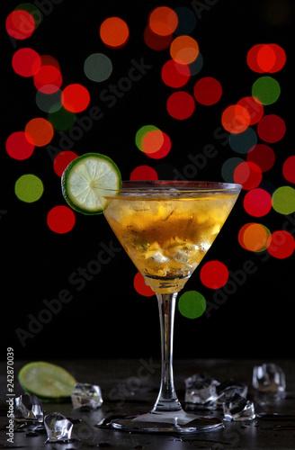 Glass of cocktail with illuminate night light