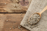 cannabis seeds on wooden background - 242872456