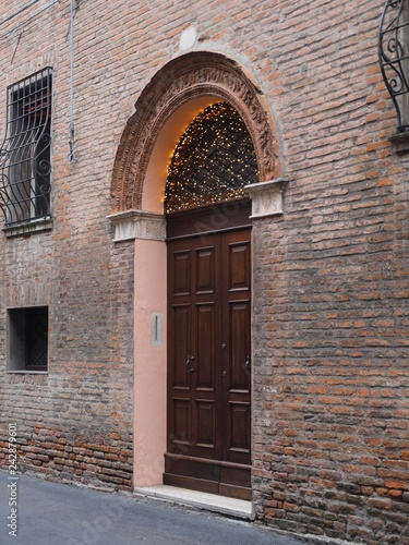 Old wooden door with Christmas ornament.