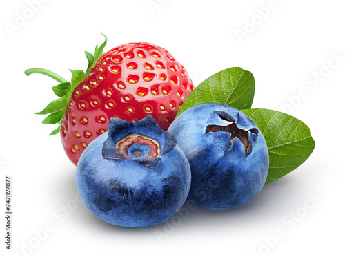 Leinwandbild Motiv Isolated berries. Two sweet blueberry and strawberry fruits with leaves isolated on white background, clipping path