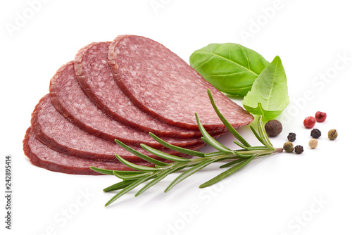 Leinwandbild Motiv Tasty Salami Sausage with herbs and spices, close-up, isolated on a white background