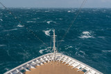 View from front at the rough seas and waves forward of bow of cruise ship - 242896680