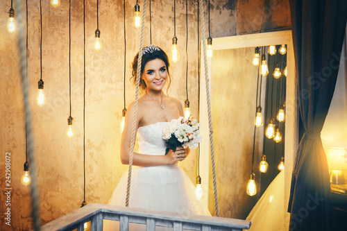 Leinwanddruck Bild Young happy bride n the room with a lot of light bulbs