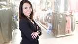 pretty brunette woman manager in a clothing store - 242911265