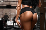 Sexy beautiful butt in thong, sexy ass. Fitness woman in gym - 242917036